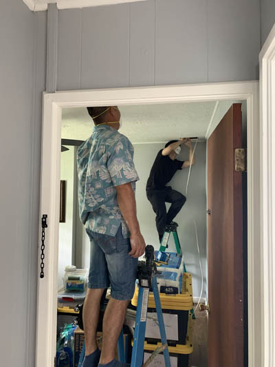 this picture shows an electrician rewiring a house in Tallahassee